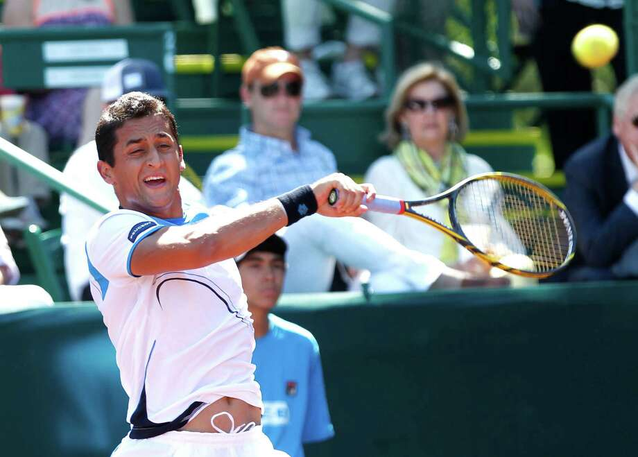 4/12/13: Nicolas Almagro (ESP) returns a serve against Paolo Lorenzi (ITA) in the River Oaks US Men's Clay Court Championship at River Oaks Country Club in Houston, Texas. Williams won 7-6,1-6,6-4. Almagro won 6-4, 6-4. Photo: Thomas B. Shea, For The Chronicle / © 2013 Thomas B. Shea