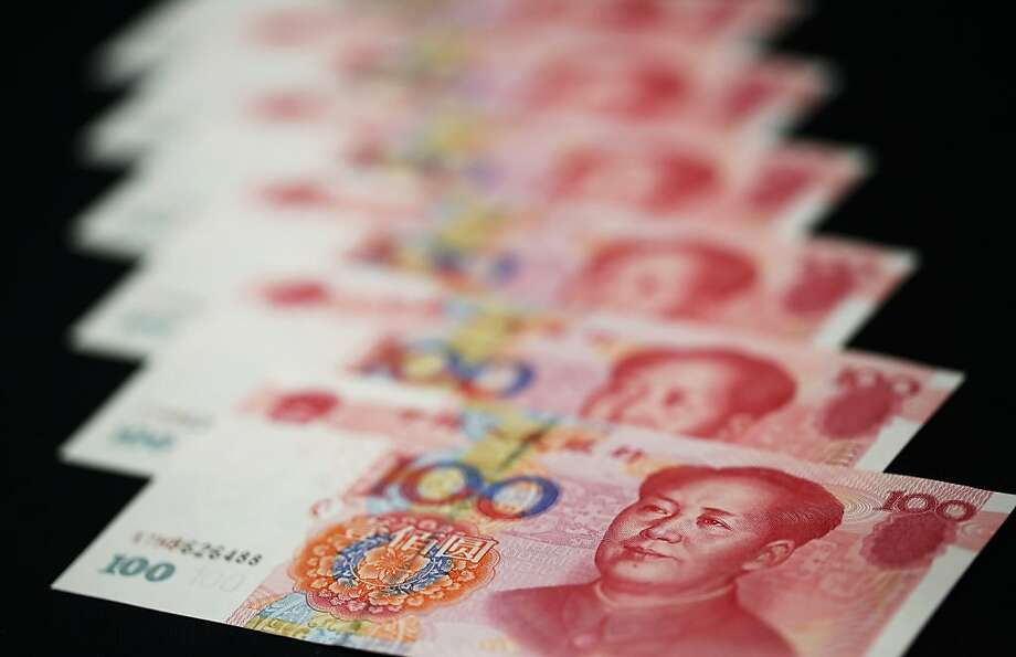 Although China's currency has risen in value by 10 percent against the dollar since June 2010, a U.S. report says the currency remains undervalued. Photo: Tomohiro Ohsumi, Bloomberg