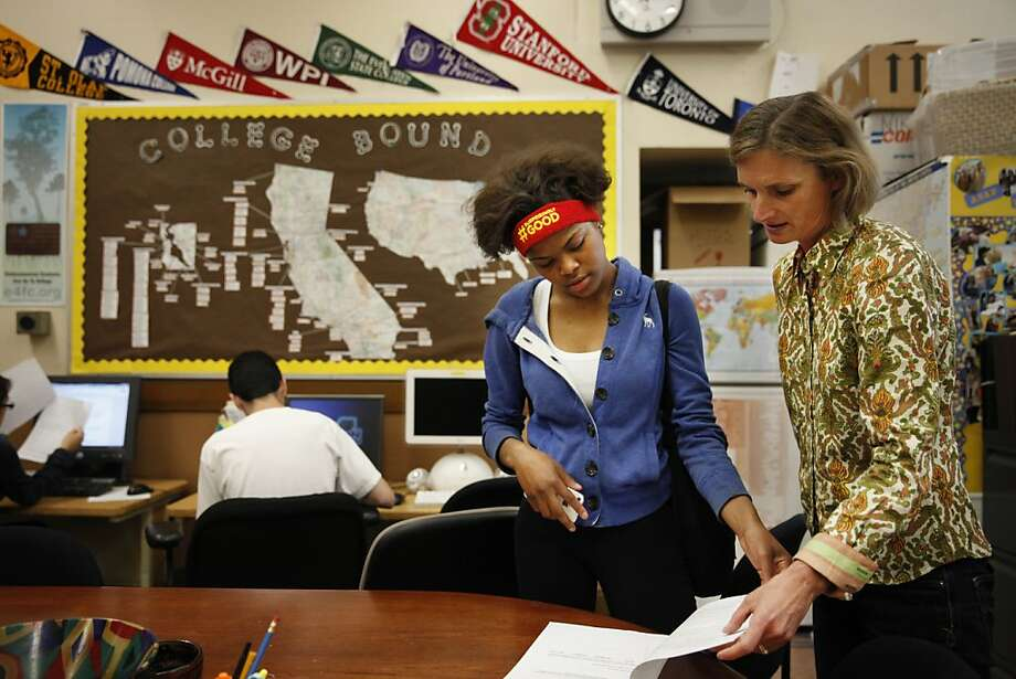 Liz Butler Steyer (right), executive director of Athletic Scholars Advancement Program hands Alexandra Edwards (left), 18, a scholarship application as the talk in the ASAP office at Mission High School on Friday, April 12, 2013 in San Francisco, Calif. Photo: Lea Suzuki, The Chronicle