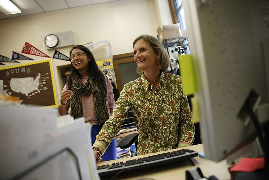 Liz Butler Steyer (right), executive director of the Athletic Scholars Advancement Program, shares a laugh with Sharon Herrera, 17, at Mission High School. ASAP helps Mission High students get into top colleges. Photo: Lea Suzuki, The Chronicle