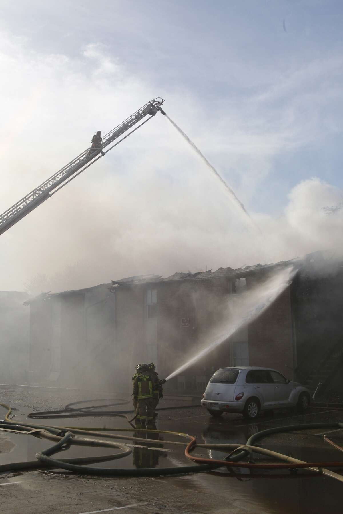 Arson investigators are looking into the fire in the 5400 block of West Gulf Bank. (Cody Duty/Chronicle)