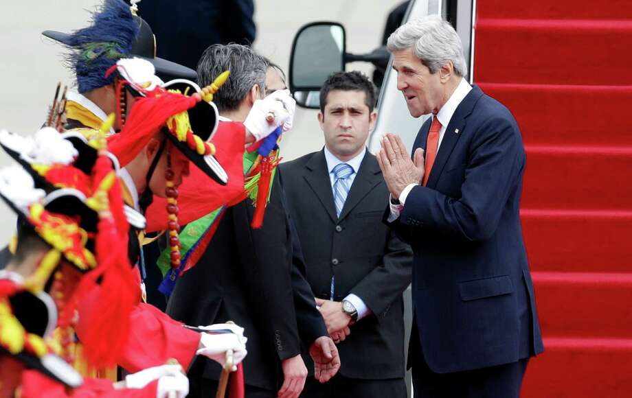 U.S. Secretary of State John Kerry, right, greets upon his arrival at Seoul military airport in Seongnam, South Korea, Friday, April 12, 2013. Kerry is traveling directly into a region bracing for a possible North Korean missile test and risking that his presence alone could spur Pyongyang into another headline-seeking provocation. (AP Photo/Lee Jin-man) Photo: Lee Jin-man