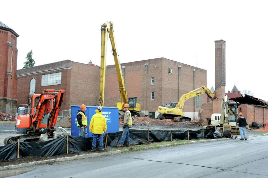 Demolition is underway of a building behind St. Patrick?s Church on Friday, April 12, 2013 in Watervliet, N.Y.  (Lori Van Buren / Times Union) Photo: Lori Van Buren