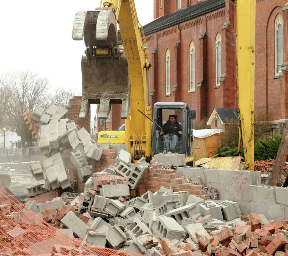 Demolition is underway of a building behind St. Patrick?s Church on Friday, April 12, 2013 in Watervliet, N.Y.  (Lori Van Buren / Times Union) Photo: Lori Van Buren