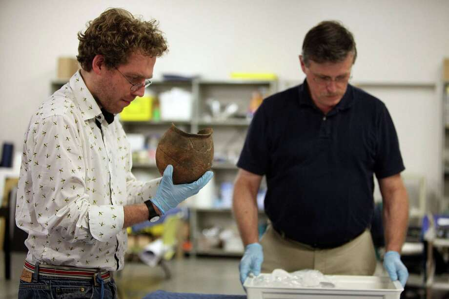 Anthropology curator Dirk Van Tuerenhout and consulting curator Tom Hardwick view a pottery vessel from 5,000 B.C. which will be on display in the new Egypt Hall at The Museum of Natural Science on Wednesday, April 10, 2013, in Houston. Photo: Mayra Beltran, Houston Chronicle / © 2013 Houston Chronicle