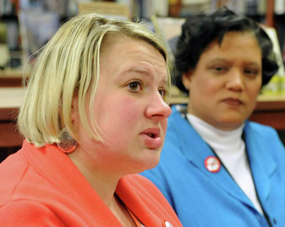 Beth Tidd, associate education project director with the Anti-Defamation League, left, expresses her disapproval of a nazi assignment at Albany High School as the Albany School District holds a joint press conference with the United Jewish Federation at the Golub Center on Friday, April 12, 2013 in Guilderland, N.Y. (Lori Van Buren / Times Union)