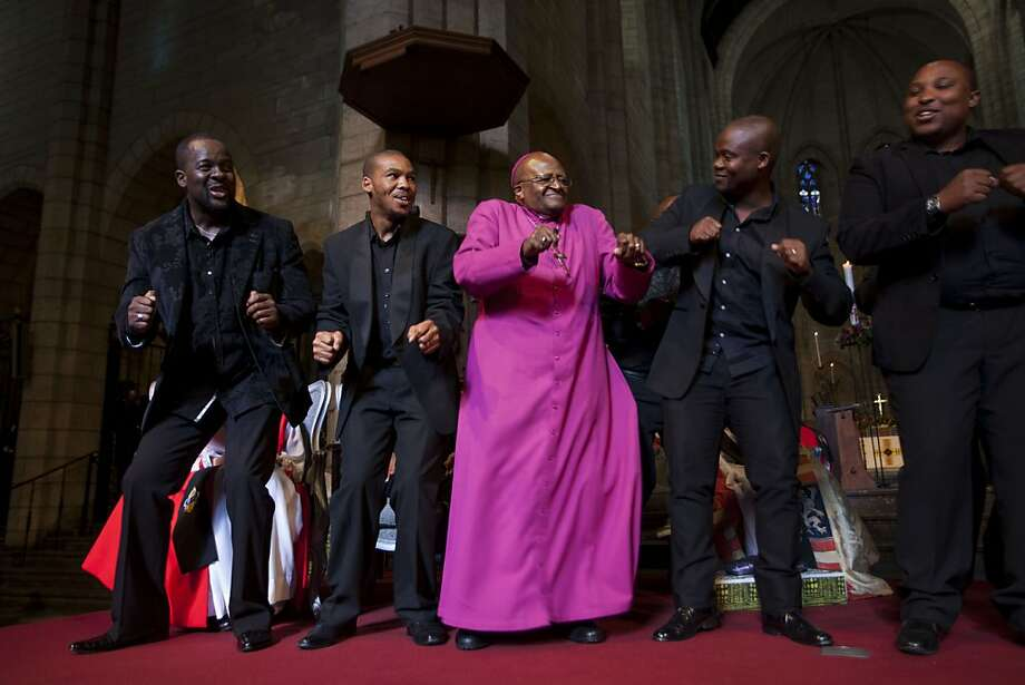 Tutu boogaloo: Archbishop Emeritus Desmond Tutu, the 2013 Templeton Prize Laureate, shakes and shimmies with the Cape Town Opera Ensemble at the Templeton Prize ceremony at Capetown's St. George's Cathedral. Photo: Ilan Godfrey, AFP/Getty Images