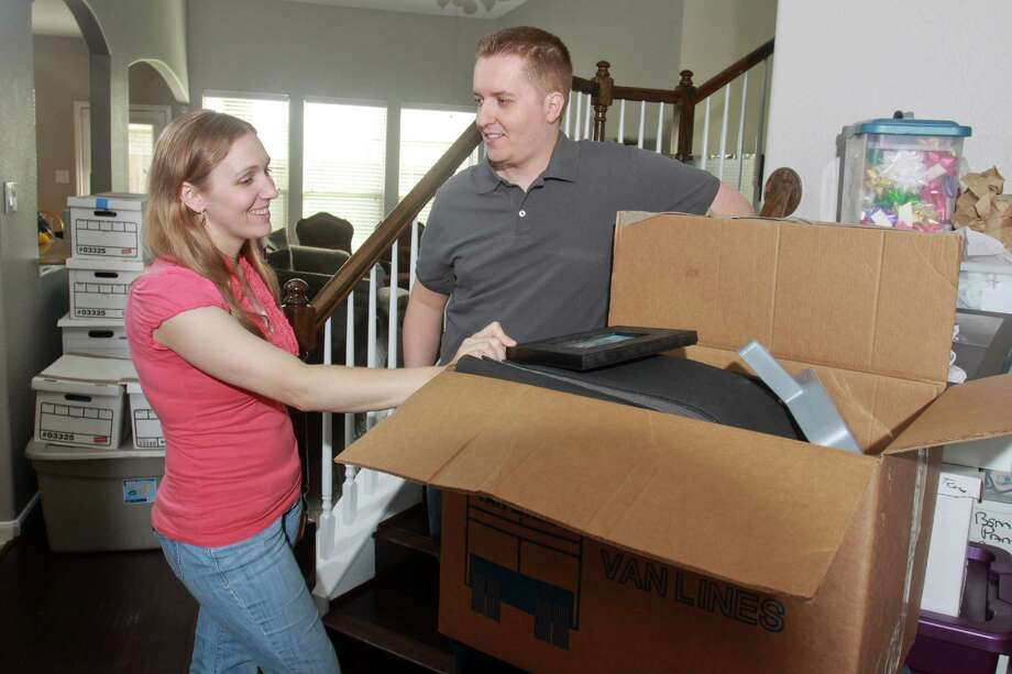 (For the Chronicle/Gary Fountain, April 1, 2013) Emily and Jay Ortiz unpacking in their new home in Richmond. They were shocked to find the Houston housing market so strong when they started looking. The couple and their two kids recently moved here from Salt Lake City. Theirs was one of multiple offers on a four-bedroom house in Lakes of Bella Terra in Richmond. In a second round of bidding they offered $5,000 more than the asking price to get the house. Photo: Gary Fountain, Freelance / Copyright 2013 Gary Fountain
