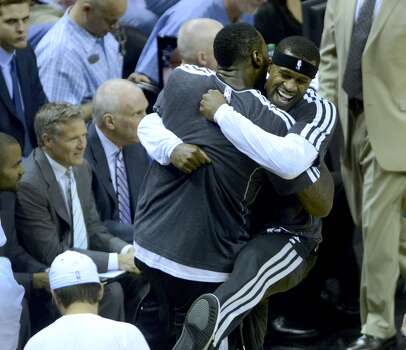 Spurs teammates DeJuan Blair (left) and Stephen Jackson embrace before the team's matchup against the Dallas Mavericks at the AT&T Center on March 14, 2013. Photo: Billy Calzada, San Antonio Express-News