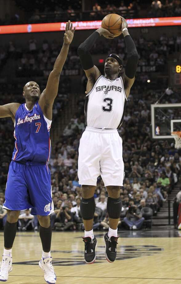 The Spurs' Stephen Jackson (3) attempts a shot against Los Angeles Clippers' Lamar Odom (07) in the second half at the AT&T Center on Friday, Mar. 29, 2013. The Spurs defeated the Clippers, 104-102. Photo: San Antonio Express-News