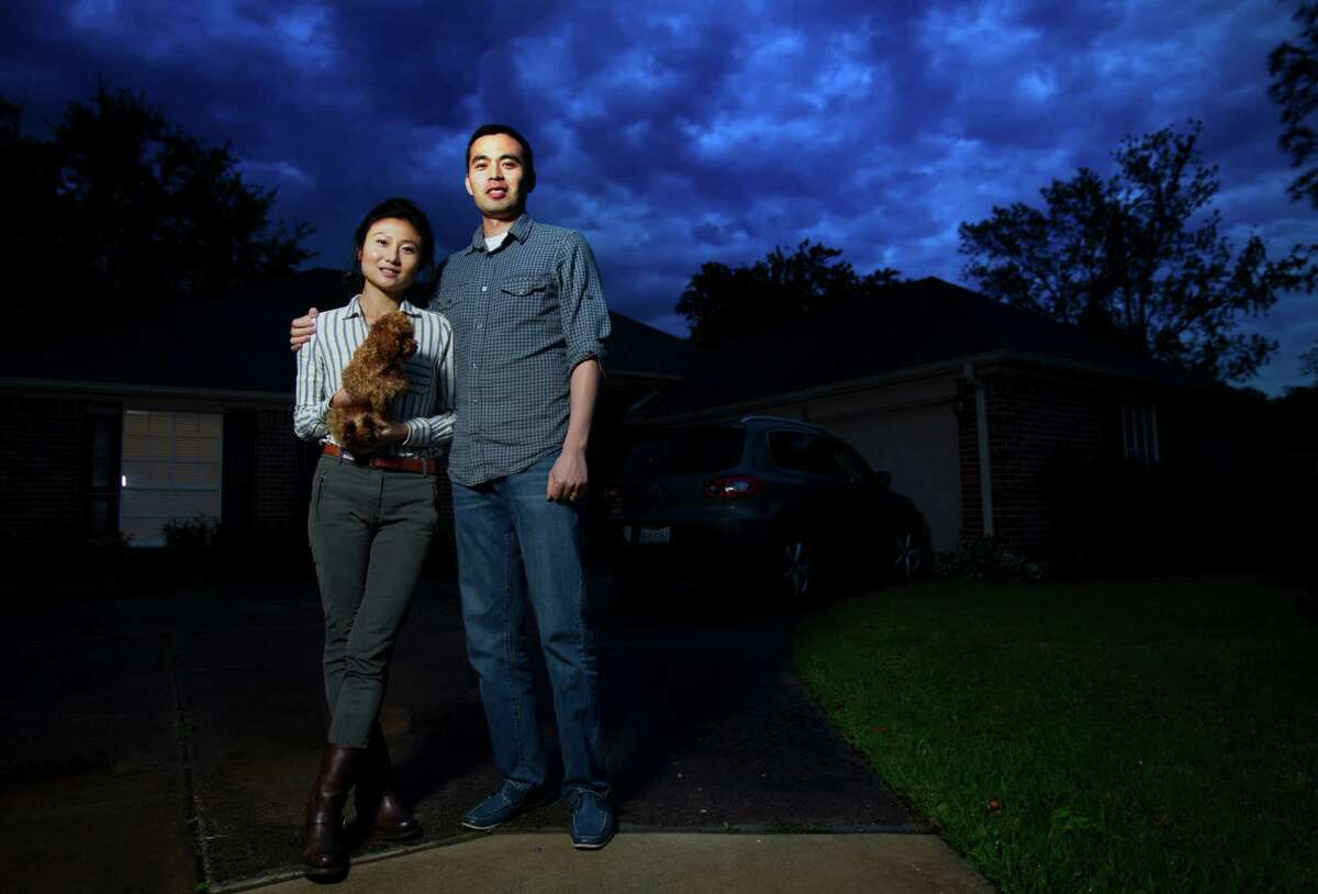 Faye Liu and Jiang Wu, and their dog, Toffee, want an Energy Corridor home. They've learned to bid high upfront in the area.