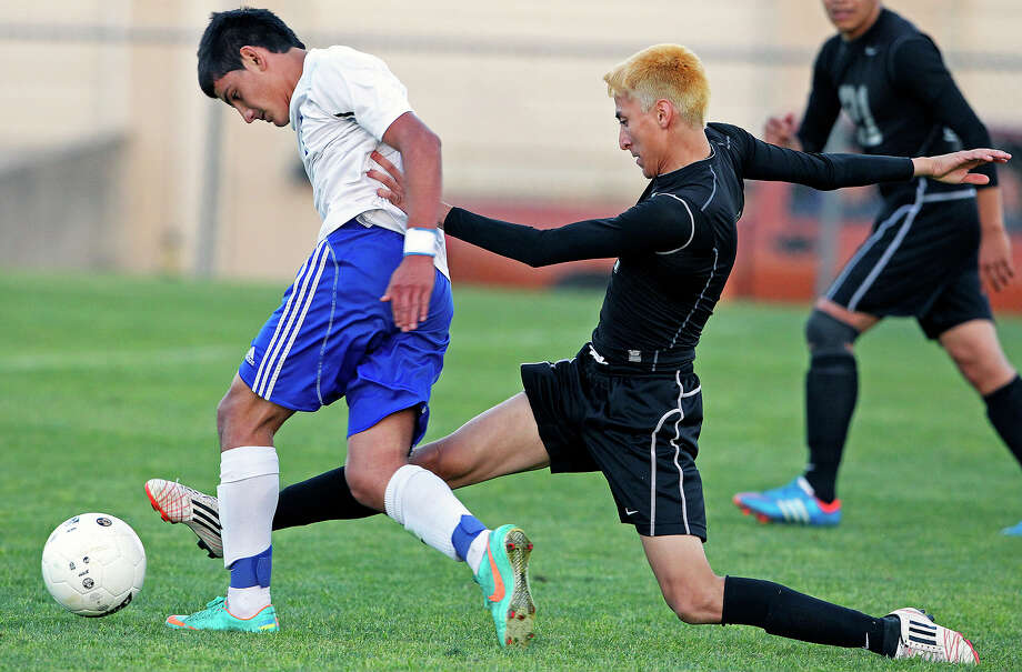 Oscar Placencia is harassed by Emmanuel Alexander as Jay plays Rivera at Blossom Athletic Center Soccer Stadium on April 12, 2013. Photo: TOM REEL, Express-News