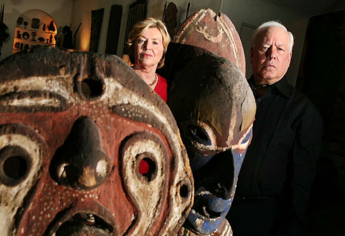 Rye, NY_Nov. 12, 2008_John and Marcia Friede pose in their living room with tribal figures from their 4,000 piece collection of art from Papua New Guinea. The Friedes are embroiled in a lawsuit with two of Mr. Friede's brothers over their mother's estate. The suit may endanger the collection, most of which has been promised to the Fine Arts Museums of San Francisco.