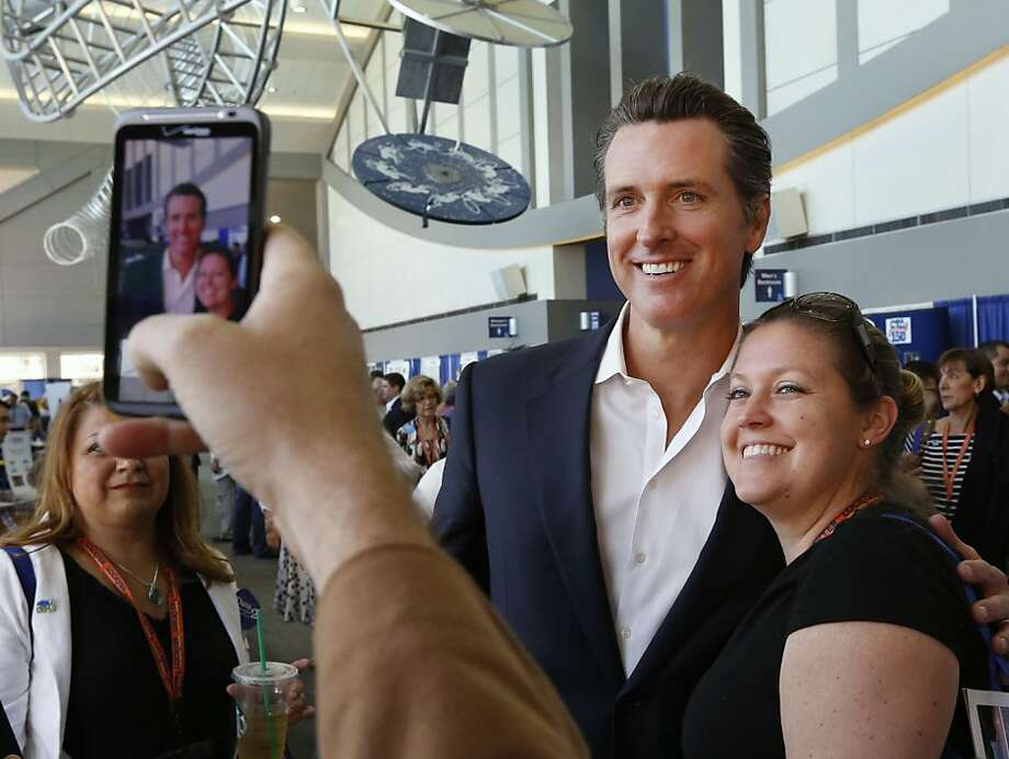 Lt. Gov. Gavin Newsom, shown with Democratic State Convention delegate Jennifer Siegert of Huntington Beach, is among the top California politicos without a clear path to higher office. Photo: Rich Pedroncelli, Associated Press