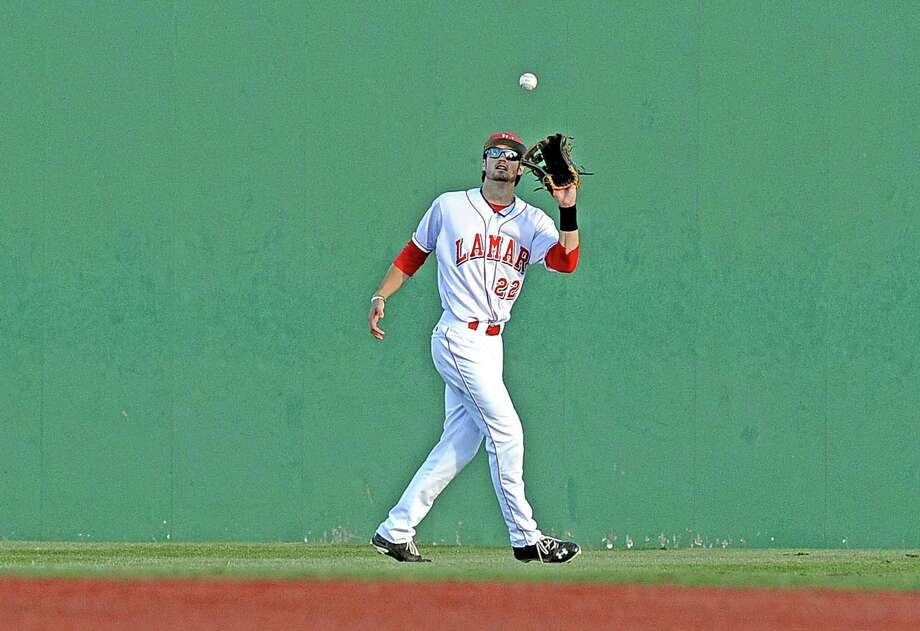 Lamar center fielder Garret Autrey, #22, catches a pop fly during the Lamar University baseball game against Sam Houston State University on Friday, April 12, 2013, at Vincent-Beck Stadium.  Photo taken: Randy Edwards/The Enterprise Photo: Randy Edwards