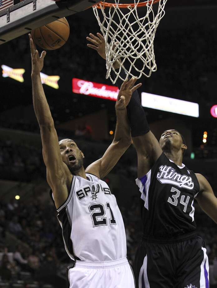 The Spurs\' Tim Duncan (21) goes up for a shot against Sacramento Kings\' Jason Thompson (34) in the second half at the AT&T Center on Friday, Apr. 12, 2013. Spurs defeated the Kings, 108-101.