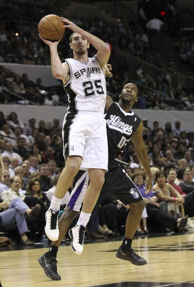 The Spurs\' Nando De Colo (25) contemplates a shot against Sacramento Kings\' Toney Douglas (00) in the second half at the AT&T Center on Friday, Apr. 12, 2013. Spurs defeated the Kings, 108-101.