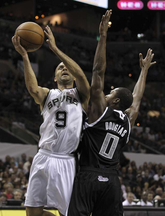 The Spurs\' Tony Parker (9) takes a shot against Sacramento Kings\' Toney Douglas (00) in the second quarter at the AT&T Center on Friday, Apr. 12, 2013.