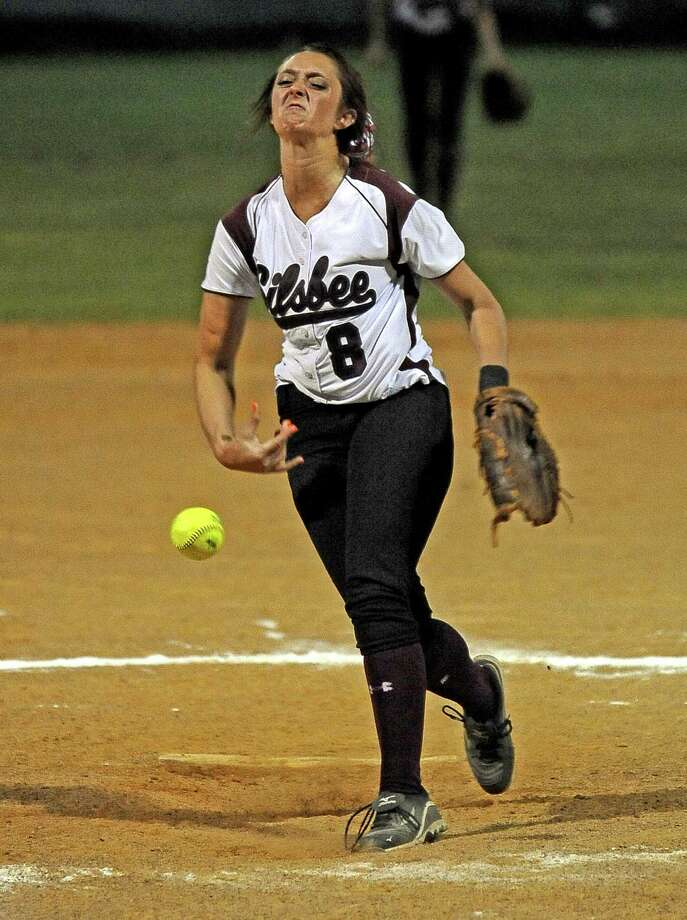 Lady Tiger Cierra Roby, #8, hurls a strike during the Silsbee High School softball game against Bridge City High School on Friday, April 12, 2013, in Silsbee. Photo taken: Randy Edwards/The Enterprise Photo: Randy Edwards