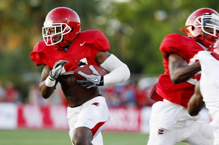 Running back Randall Holliman #34 rushes in the UH Spring game at the University of Houston in Houston, Texas in April.
