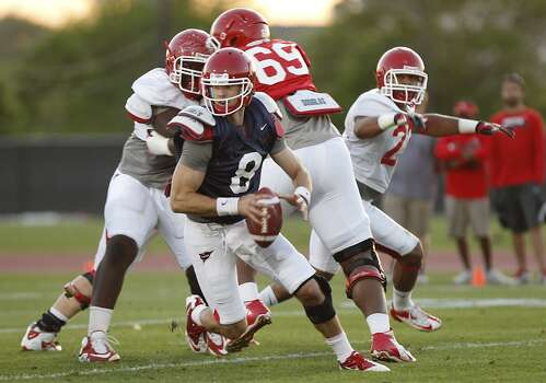 4/12/13: Quarterback David Piland #8 scrambles and then rushes for a gain in the UH Spring game at the University of Houston in Houston, Texas.