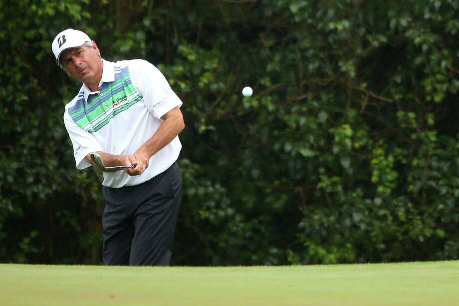 AUGUSTA, GA - APRIL 12:  Fred Couples of the United States chips the ball on the fifth hole during the second round of the 2013 Masters Tournament at Augusta National Golf Club on April 12, 2013 in Augusta, Georgia.  (Photo by Mike Ehrmann/Getty Images) Photo: Mike Ehrmann