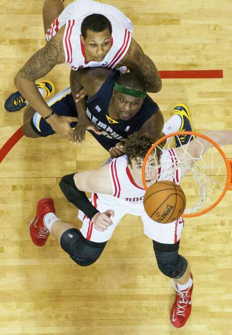 All eyes are on the rebound as Rockets center Omer Asik, bottom, and forward Greg Smith, top, fight for position with Grizzlies forward Zach Randolph. Photo: Smiley N. Pool, Staff / © 2013  Houston Chronicle