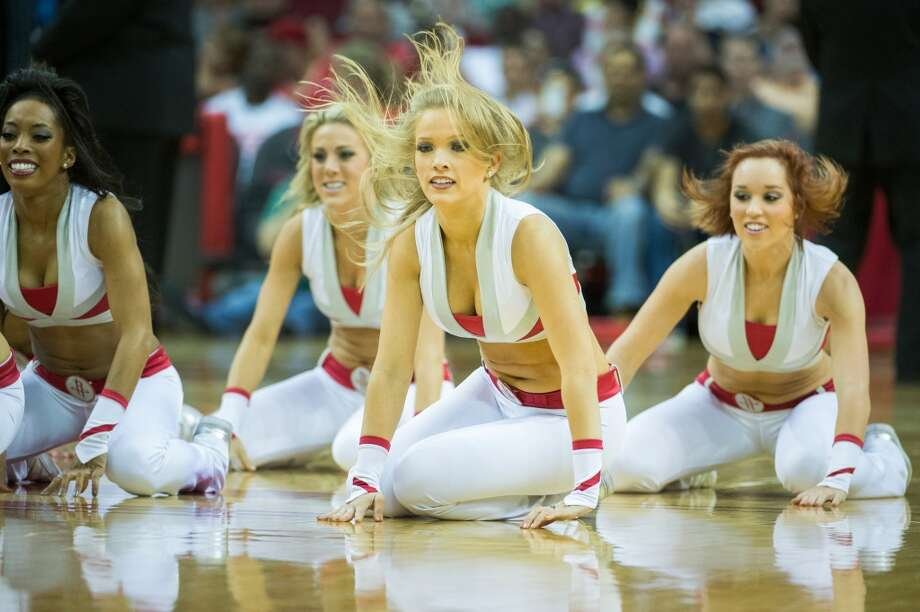 The Rockets Power Dancers perform during a basketball game between the Houston Rockets and the Memphis Grizzlies. Photo:  Smiley N. Pool, Houston Chronicle