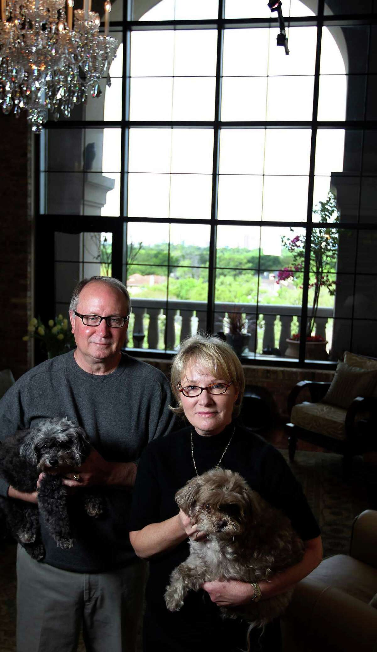 Bob and Pat Ballard in their Renoir condo on Shepherd, Saturday, April 6, 2013, in Houston. They sold their West U home one hour after putting it on the market. They now live in a condo, the Renoir, so they can spend more time at their lake house on Lake Livingston. ( Karen Warren / Houston Chronicle )