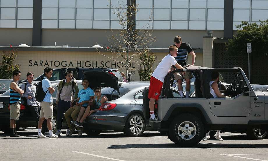 Teenage boys from Saratoga High School relax in the parking lot after school on Friday, April 12. Three arrests were made in connection to the suicide of a 16-year-old after she was sexually assaulted last fall. Photo: James Tensuan, The Chronicle