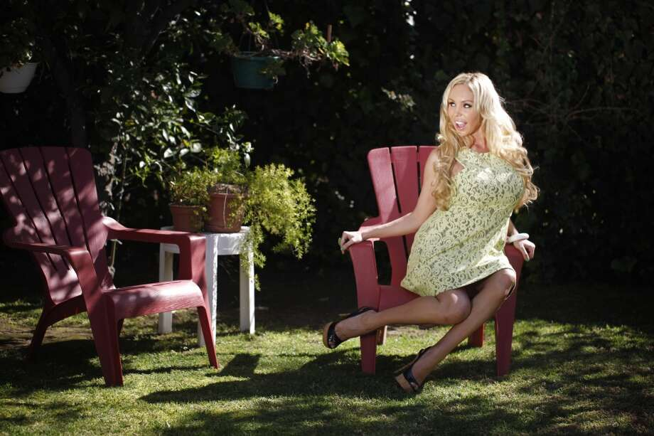 Ten years after Gov. Gray Davis was recalled, former gubernatorial candidate, Mary Carey, known for work in the porn industry, sits in a Glendale, Calif. yard on March 12, 2013.