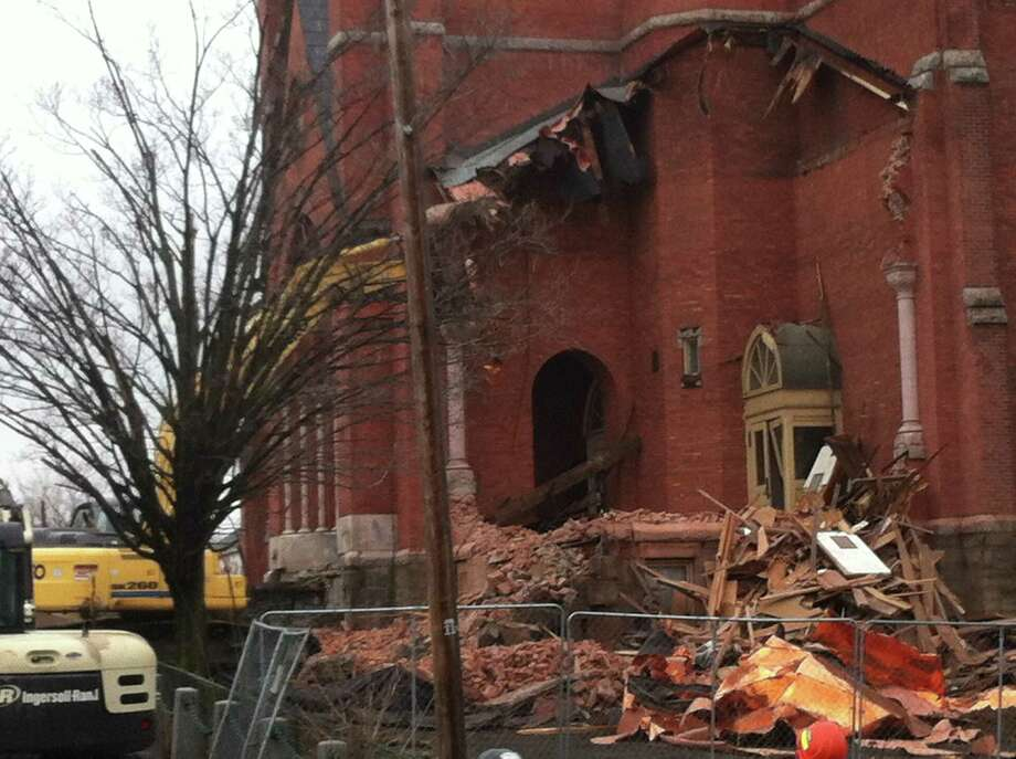 Demolition of St. Patrick's Church in Watervliet began on Saturday morning. (Kenneth C. Crowe II/Times Union)