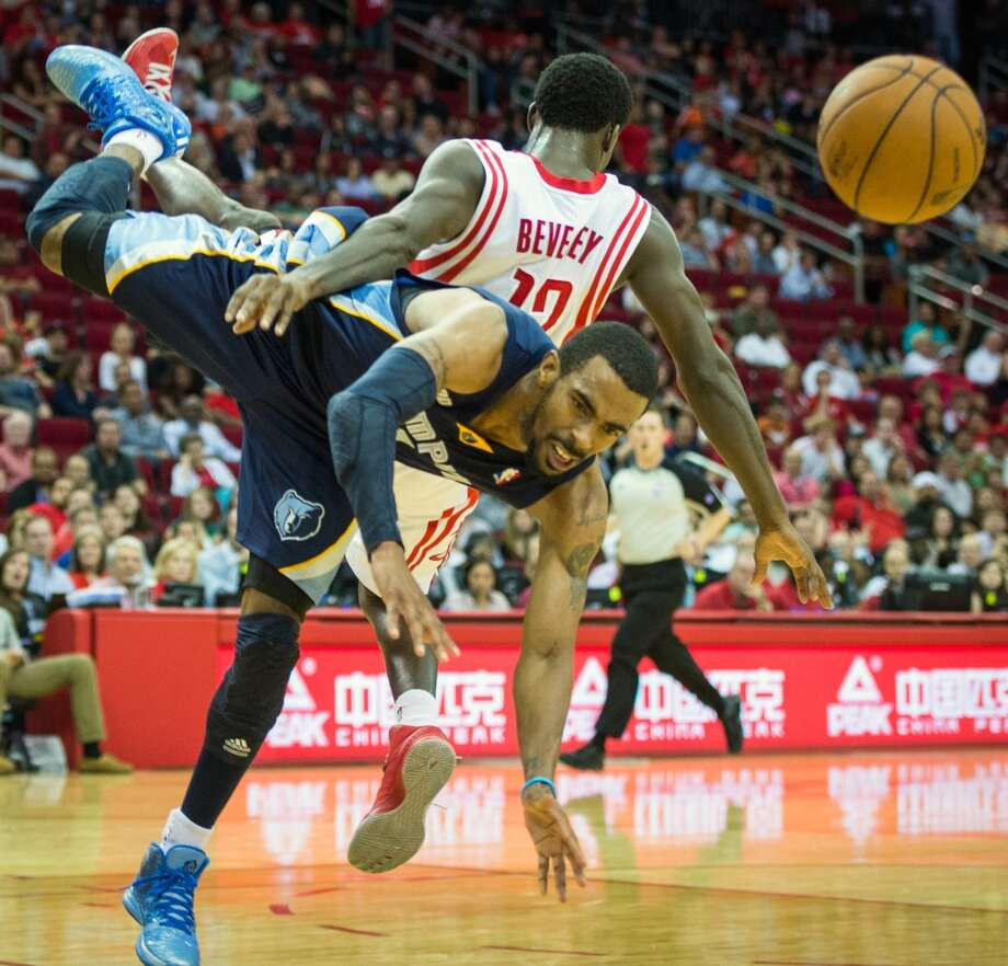 Rockets guard Patrick Beverley comes crashing down on Grizzlies guard Mike Conley. Photo:  Smiley N. Pool, Houston Chronicle