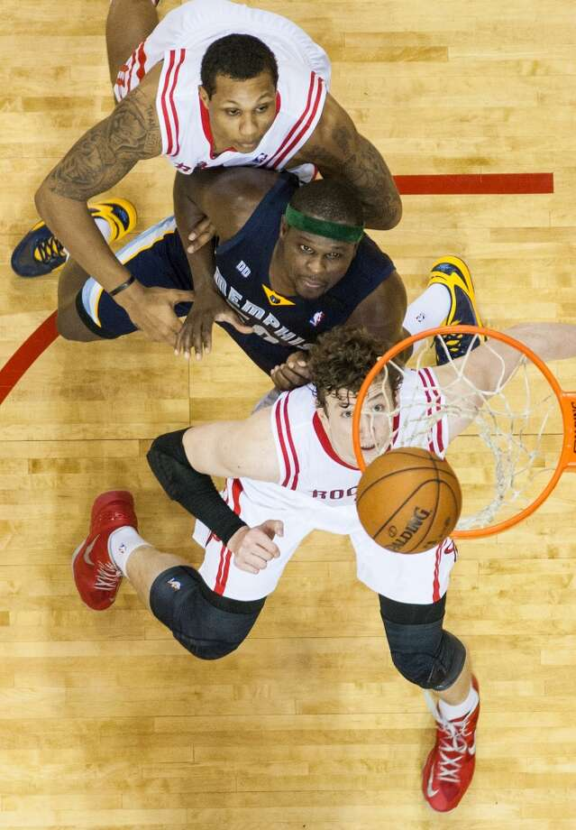 All eyes are on the rebound as Rockets center Omer Asik, bottom, and forward Greg Smith, top, fight for position with Grizzlies forward Zach Randolph. Photo:  Smiley N. Pool, Houston Chronicle