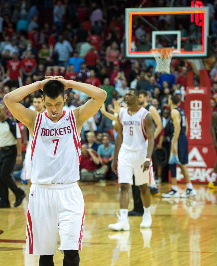 Rockets guard Jeremy Lin reacts after James Harden missed on a 3-point shot at the buzzer.