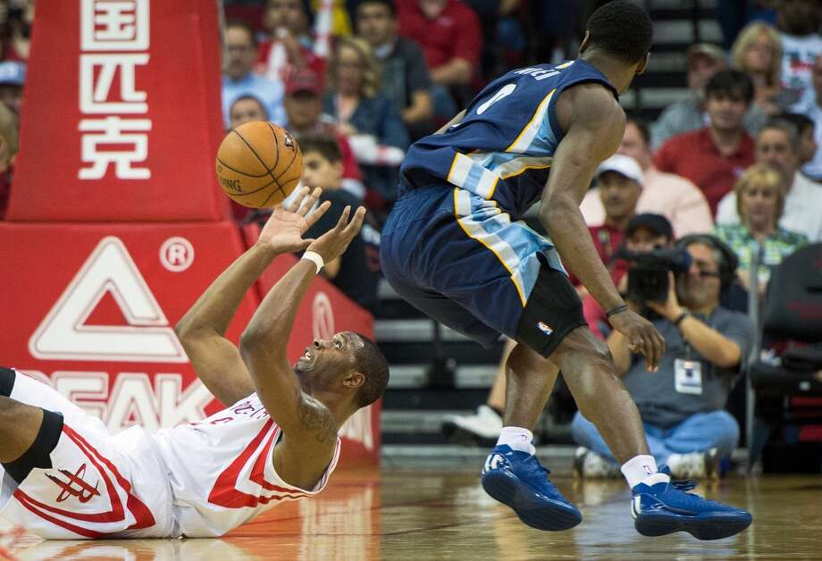 Rockets power forward Terrence Jones falls the floor chasing a loose ball as Grizzlies shooting guard Tony Allen gives chase.