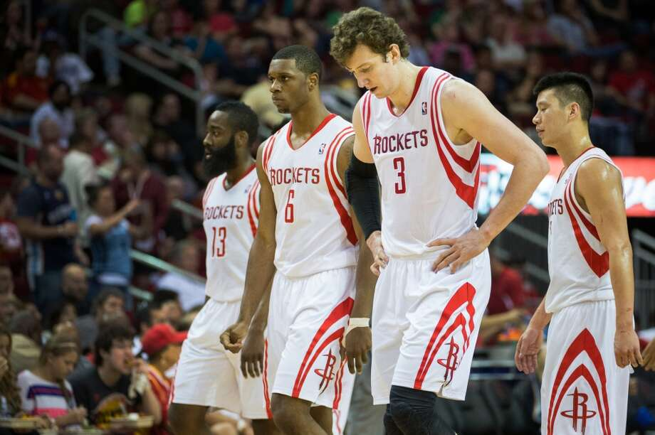 Rockets players James Harden, Terrence Jones, Omer Asik and Jeremy Lin walk to the bench during a break in action.