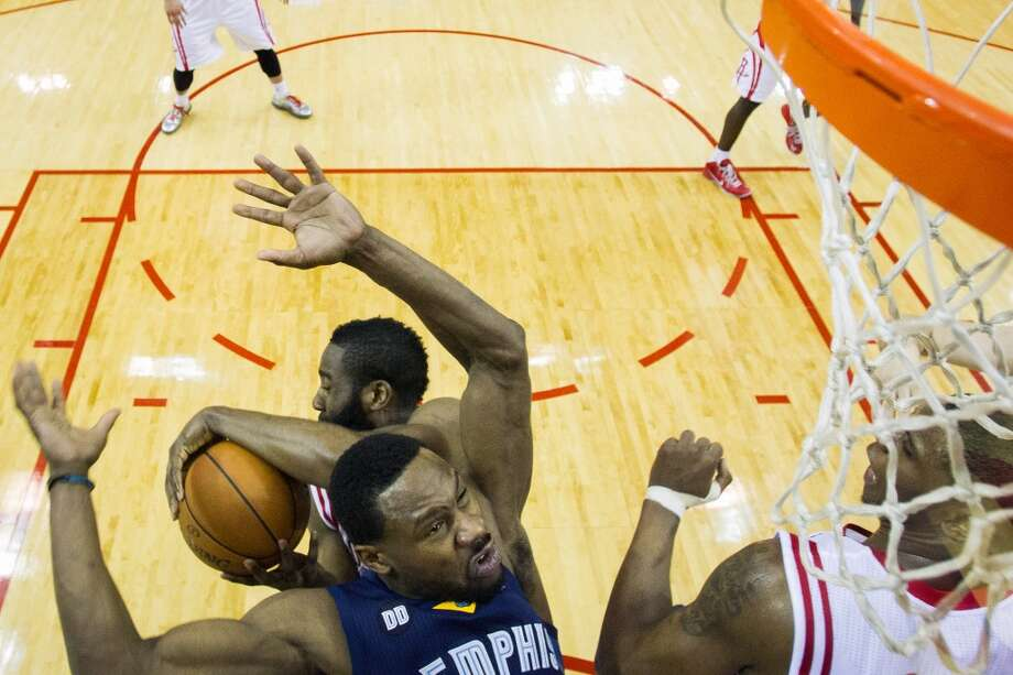Rockets guard James Harden wrestles a rebound away from Grizzlies guard Tony Allen.