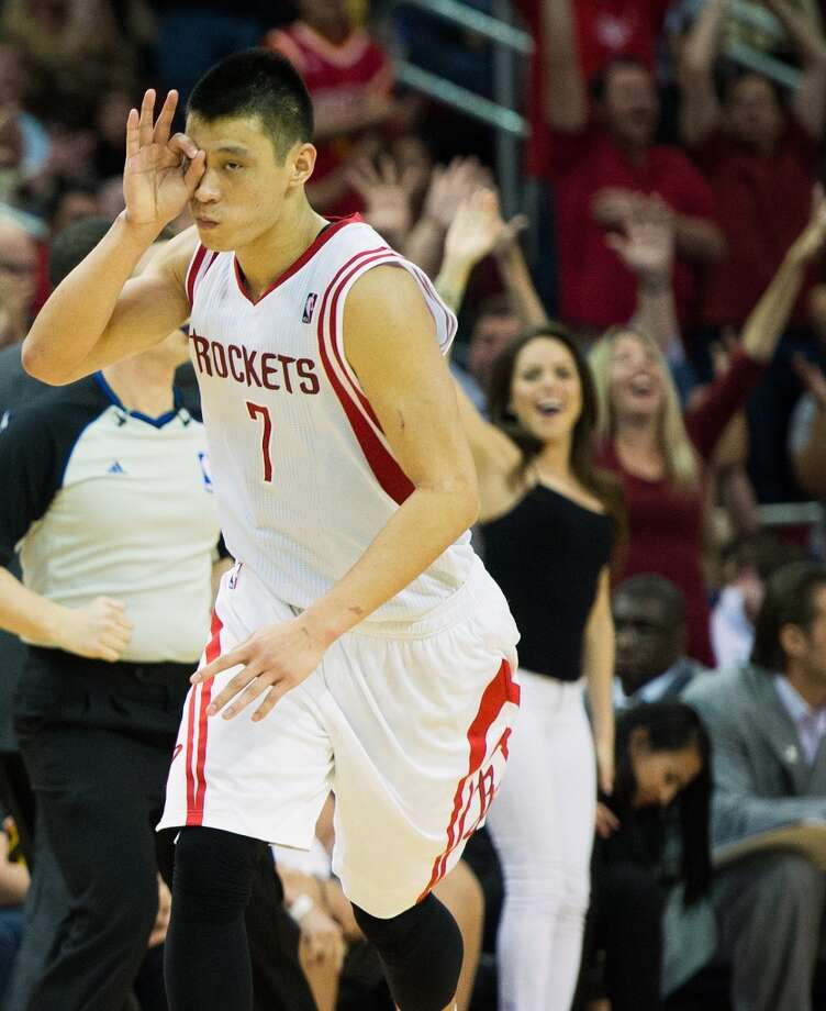 Rockets guard Jeremy Lin celebrates after sinking a 3-pointer to tie the game at 78-78 with 1:30 left to play.