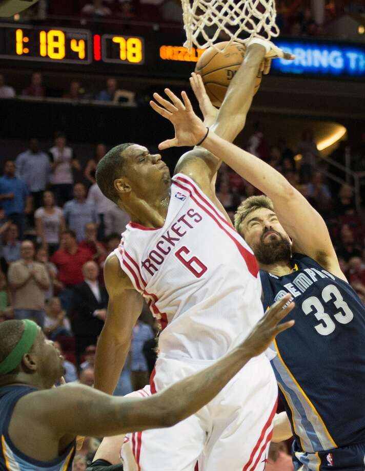 Rockets power forward Terrence Jones picks up a foul as he knocks the ball away from Memphis Grizzlies center Marc Gasol.
