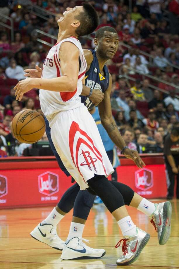 Rockets point guard Jeremy Lin is fouled by Grizzlies point guard Keyon Dooling.