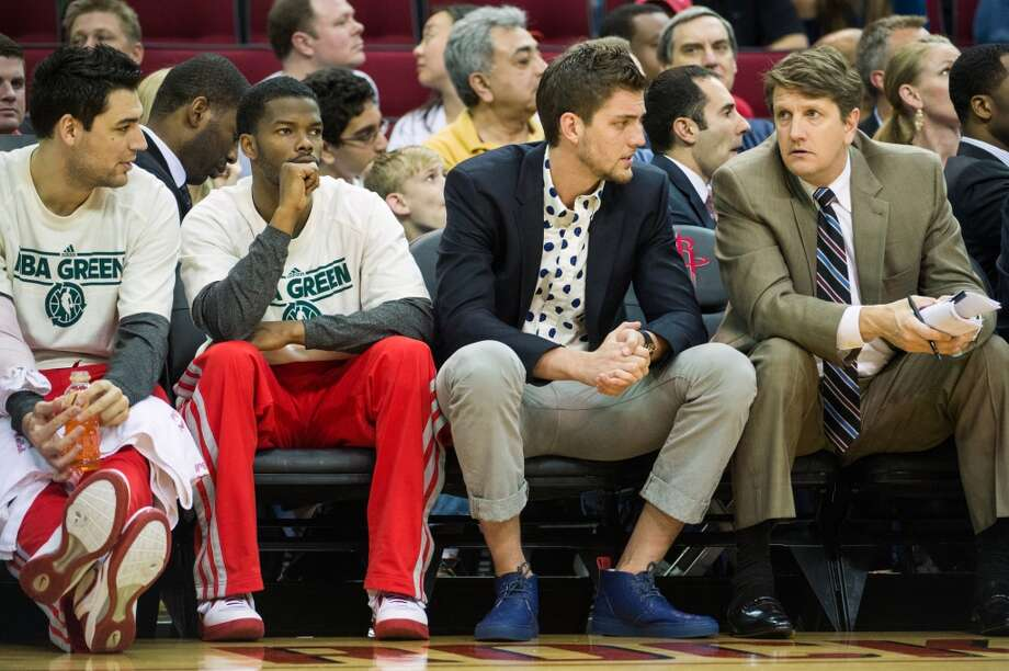 Rockets small forward Chandler Parsons sits on the bench during the first half.  Parsons sat out against Memphis with a strained left calf. Photo:  Smiley N. Pool, Houston Chronicle