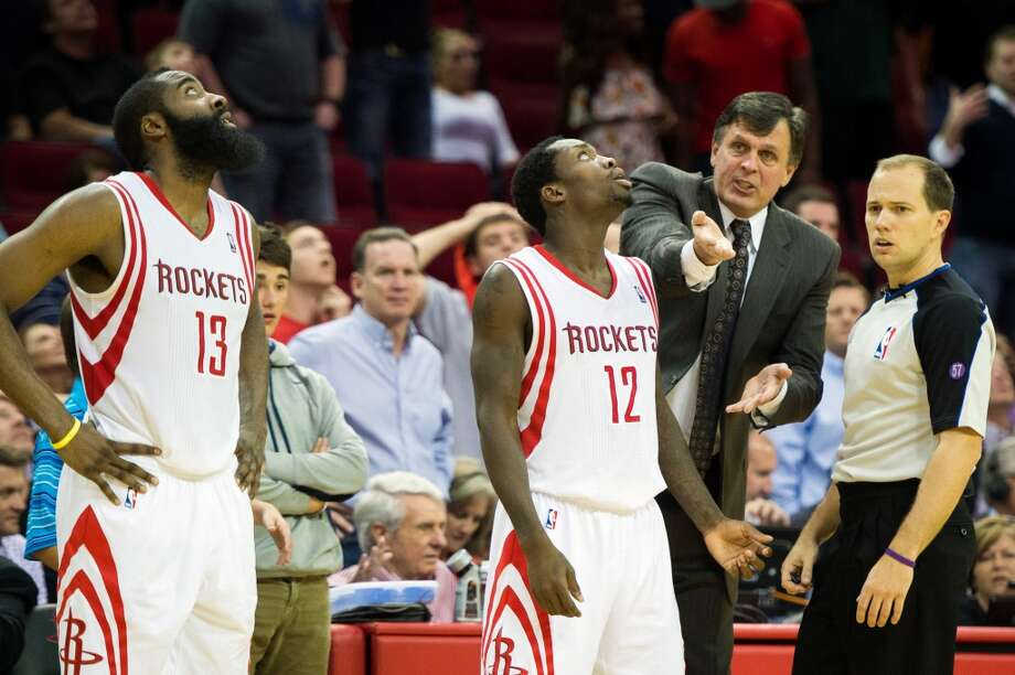 Rockets head coach Kevin McHale lobbies for a call as James Harden and Patrick Beverley watch a replay.