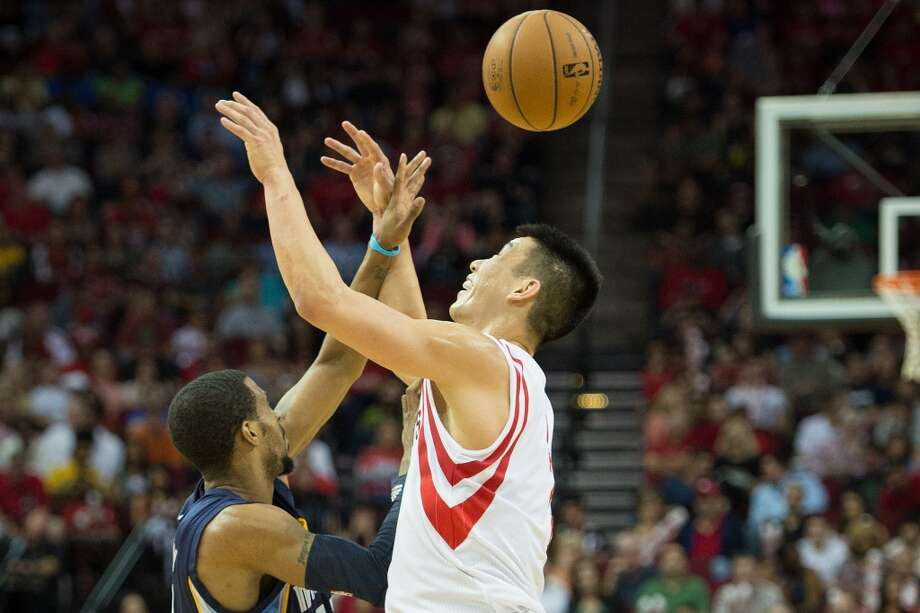 Grizzlies point guard Mike Conley  knocks the ball away from Rockets point guard Jeremy Lin for a steal. Photo:  Smiley N. Pool, Houston Chronicle