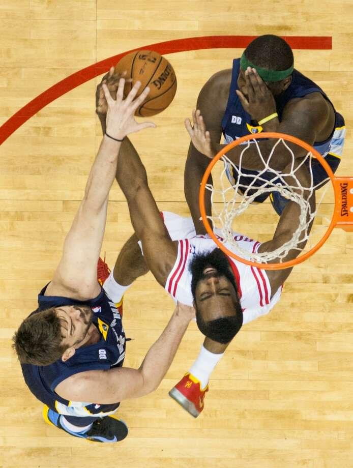 Rockets shooting guard James Harden hits Grizzlies power forward Zach Randolph in the face as he fights for a rebound with Randolph and Grizzlies center Marc Gasol.