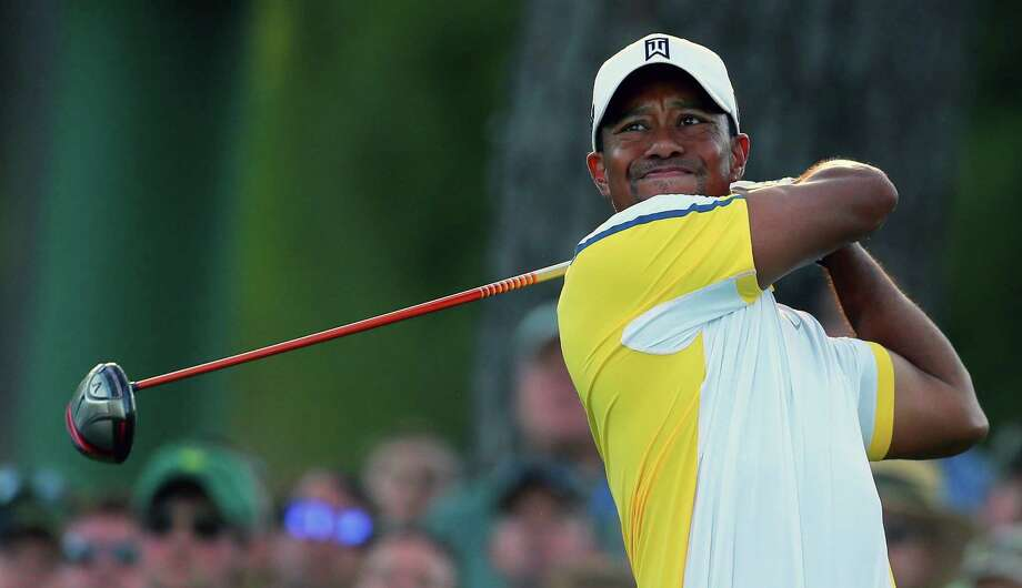 Tiger Woods is back on top of Forbes' list of highest-paid athletes. The star golfer spent 11 straight years at No. 1 on the magazine's list before falling to third in 2012. The magazine put him back in the top spot after he made $78.1 million over the last year from prize money, endorsements, appearance fees and golf course design work. Woods has enjoyed a resurgence in his play that has earned him over $13.1 million the past 12 months — double his total from the prior year. Photo: CURTIS COMPTON, McClatchy-Tribune News Service / Atlanta Journal-Constitution