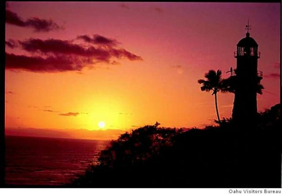 Sunset illuminates Diamond Head Lighthouse.