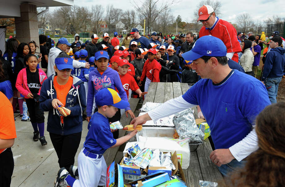 An Opening Day Ceremony was held for teams in the Black Rock Little League at Ellsworth Field in Bridgeport, Conn. on Saturday April 13, 2013. Photo: Christian Abraham / Connecticut Post