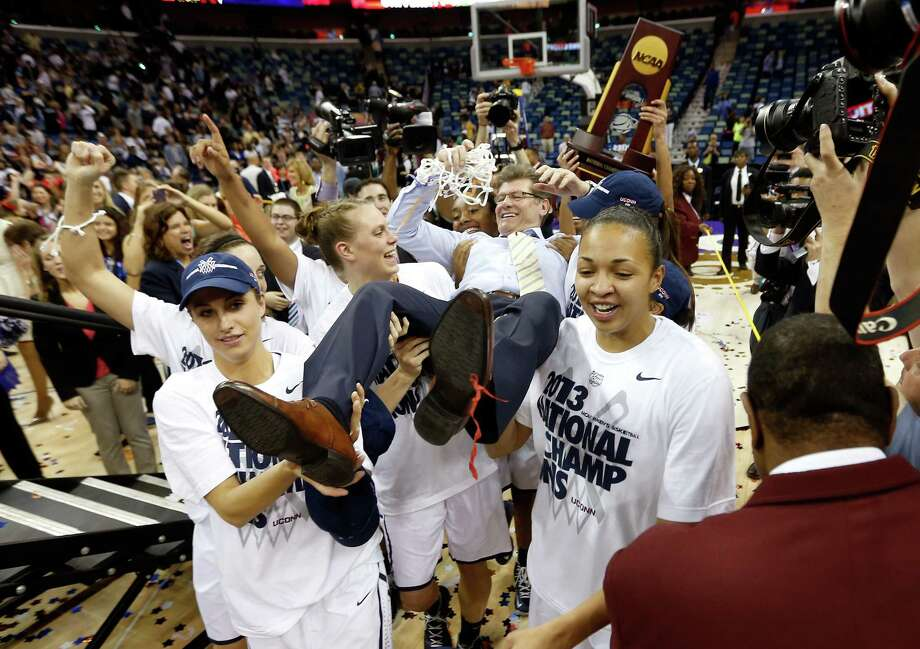 NEW ORLEANS, LA - APRIL 09:  Head coach Geno Auriemma of the Connecticut Huskies is carried off the court by his players after defeating the Louisville Cardinals winning his eighth National Championship during the 2013 NCAA Women's Final Four Championship at New Orleans Arena on April 9, 2013 in New Orleans, Louisiana.  (Photo by Chris Graythen/Getty Images) Photo: Chris Graythen, Getty Images / 2013 Getty Images