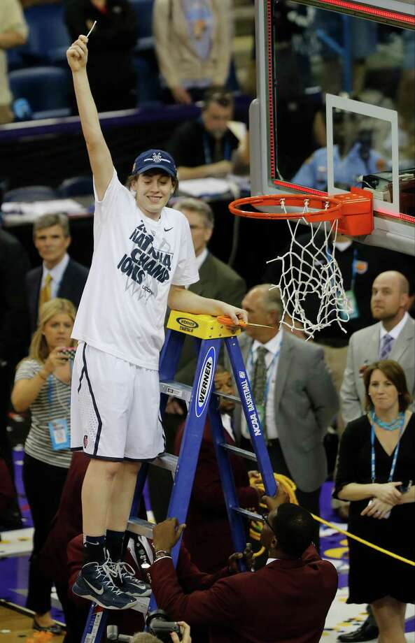 Connecticut forward Breanna Stewart (30) holds a piece of the net after defeating Louisville 93-60 in the national championship game of the women's Final Four of the NCAA college basketball tournament, Tuesday, April 9, 2013, in New Orleans.  (AP Photo/Bill Haber) Photo: Bill Haber, Associated Press / FR170136 AP